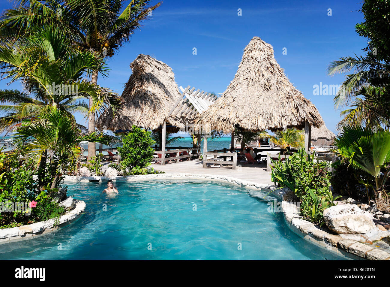 Hotel swimming pool with views onto the ocean, San Pedro, Ambergris Cay Island, Belize, Central America, Caribbean Stock Photo