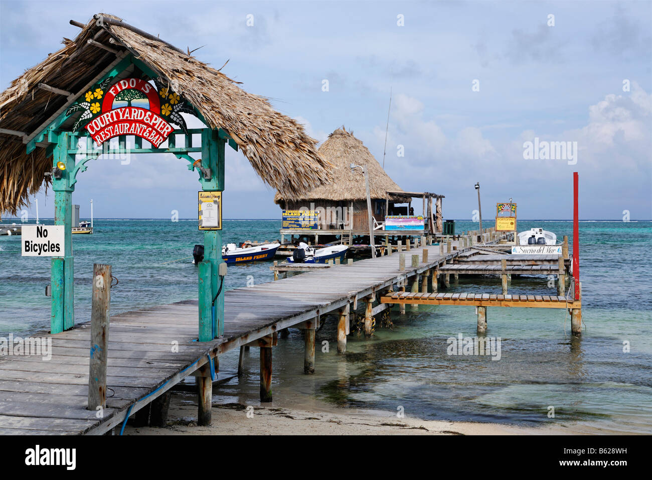 Restaurant at the end of a pier in the ocean of San Pedro, Ambergris Cay Island, Belize, Central America, Caribbean Stock Photo