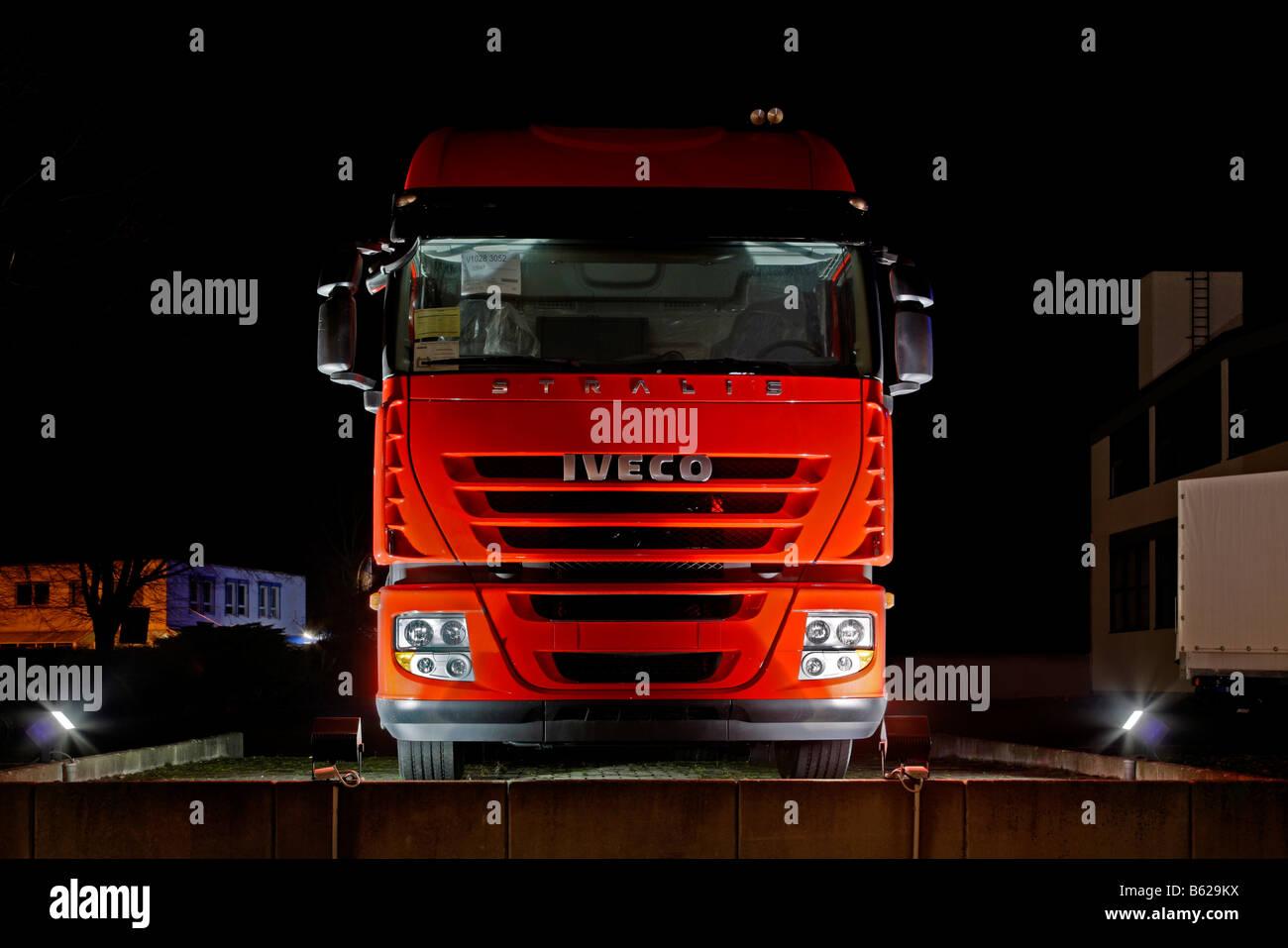 Truck, semi, trailer, new Iveco vehicle, night photograph, DRI - Stock Image