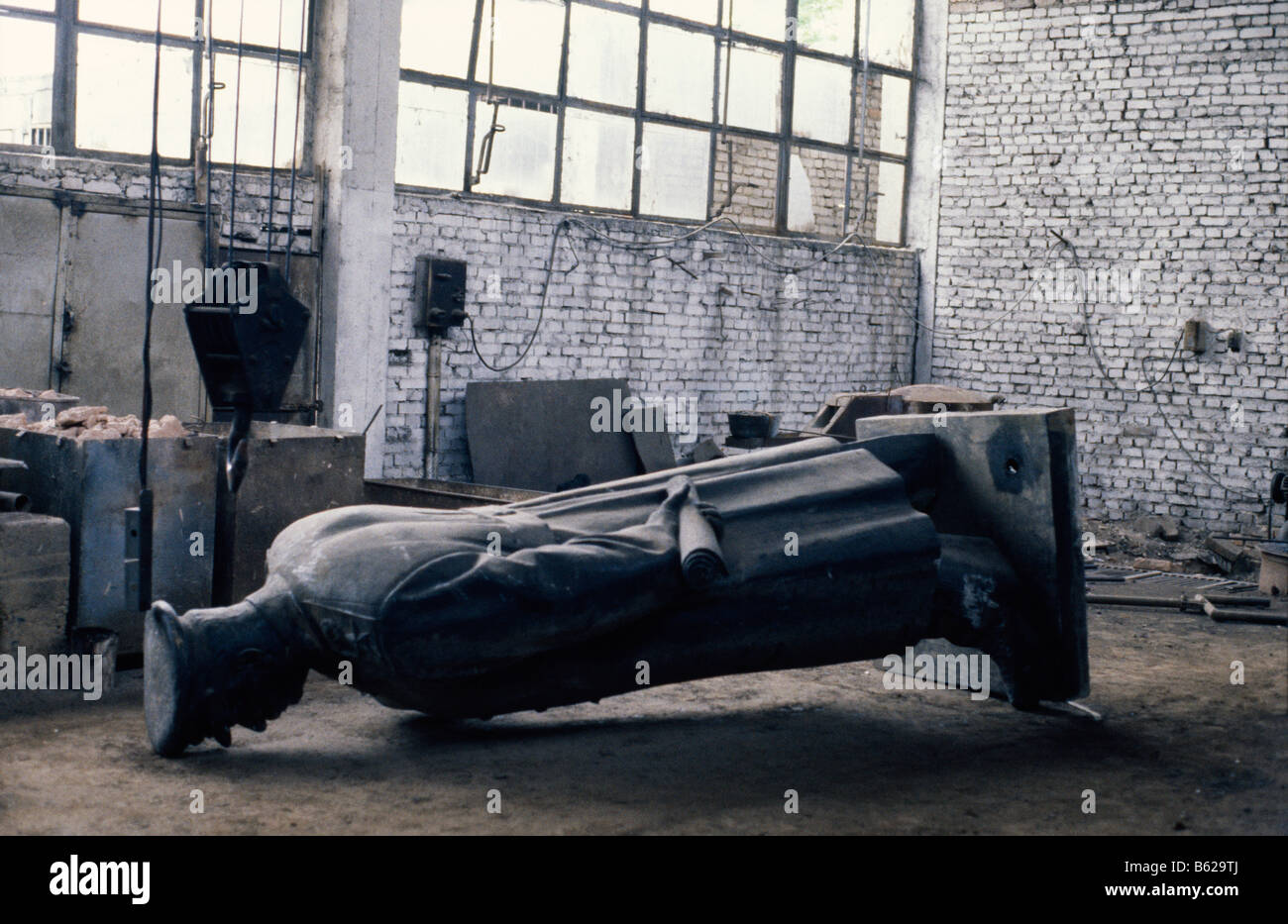 Statue of Joseph Stalin lays face down in the metal foundry where it was once built in Tirana, Albania, 1992 - Stock Image