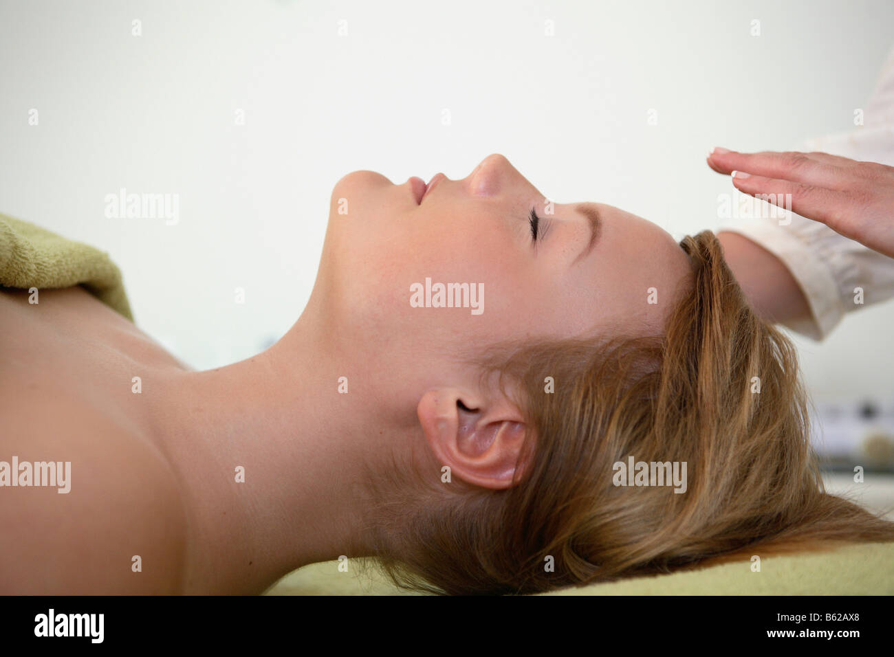 Girl in a beauty parlour before getting a facial - Stock Image