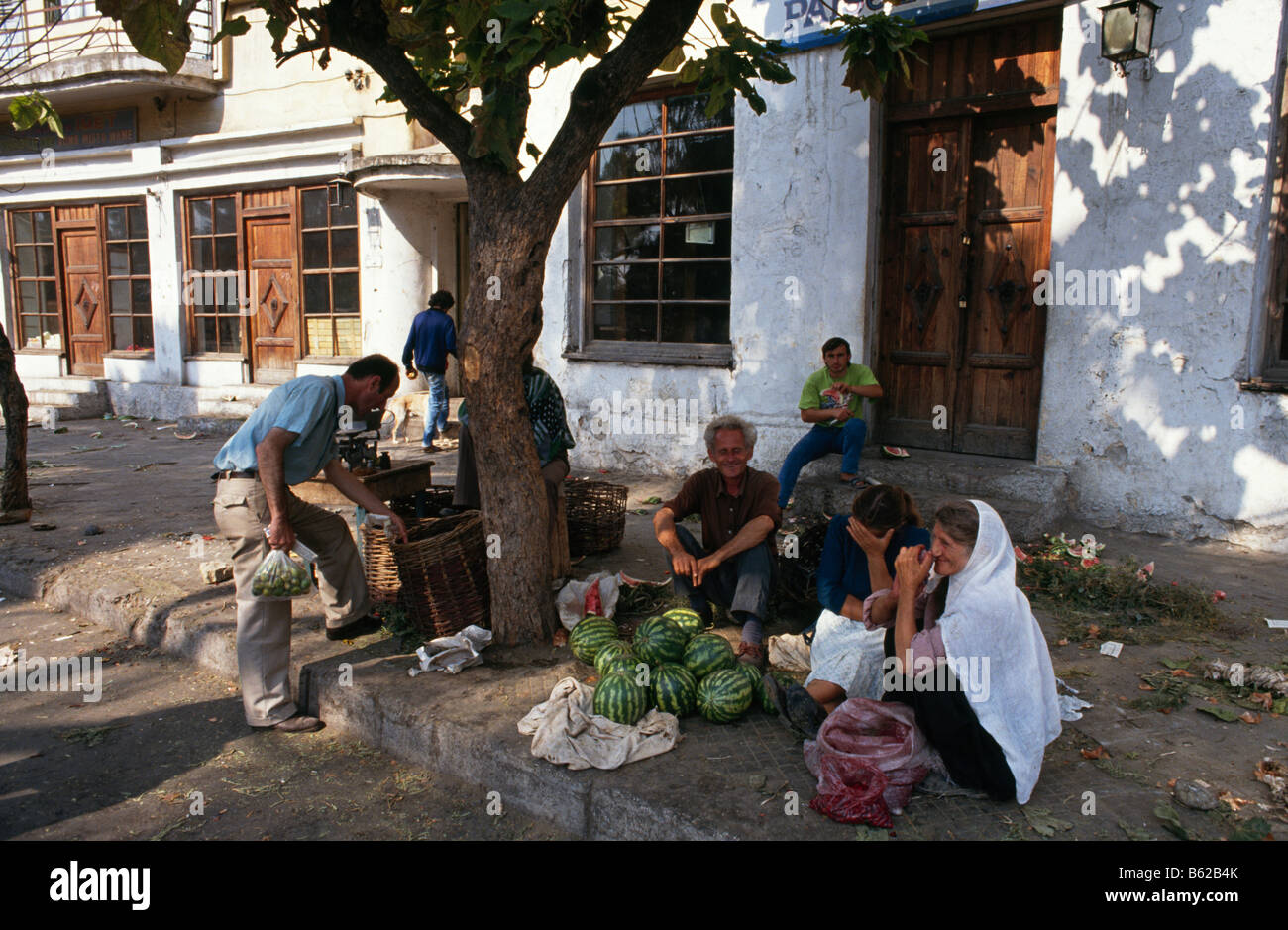 Street scene with people selling watermelons in Tirana, Albania 1994 - Stock Image