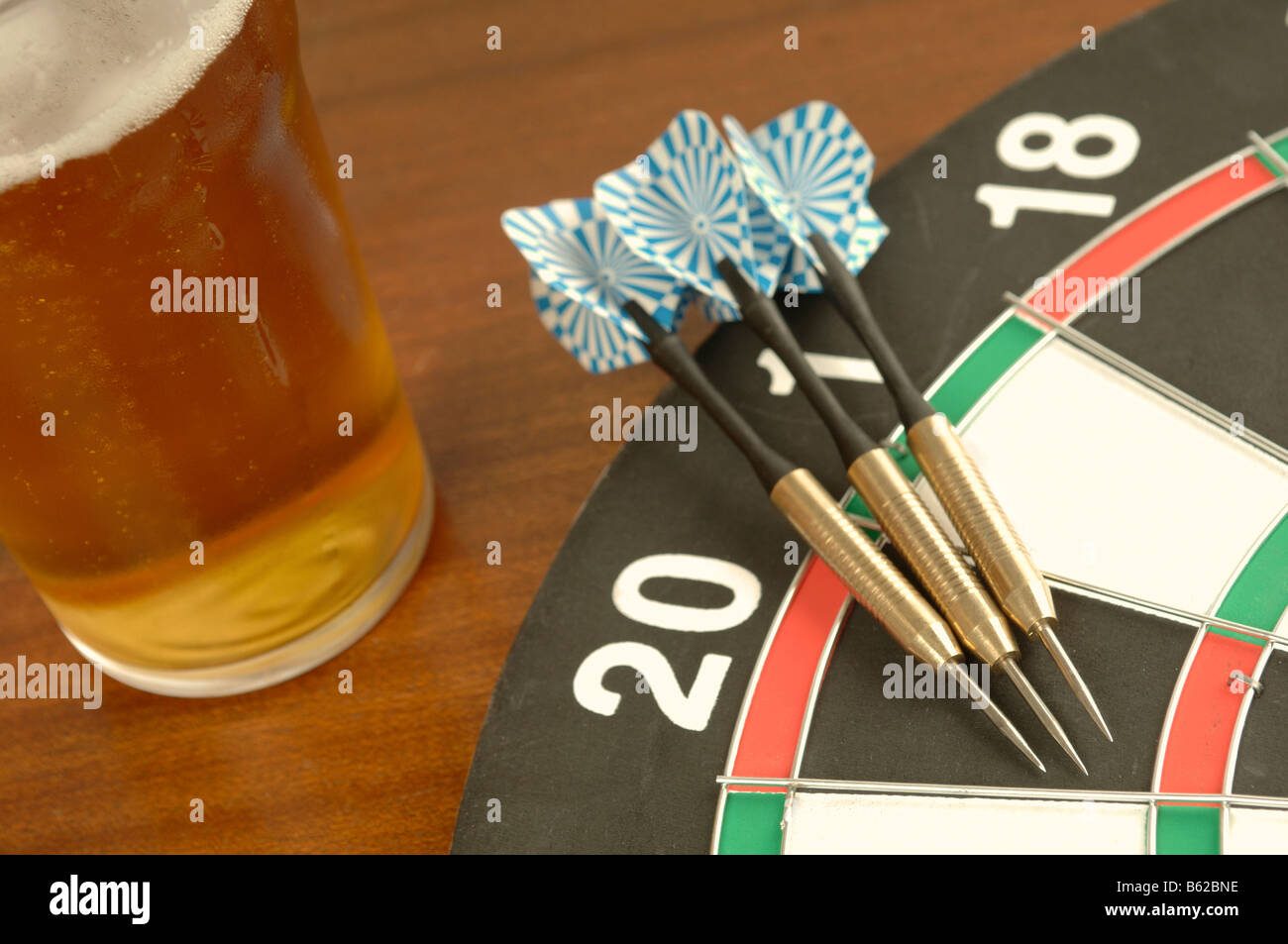 a selection of pub games including darts and dominoes - Stock Image