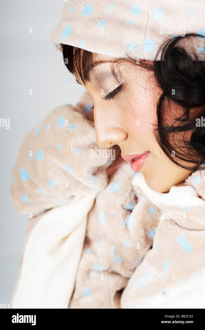 Young woman dressed in winter clothes - Stock Image