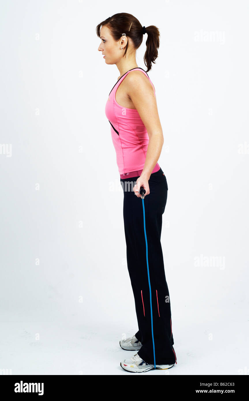Young woman holding a skipping rope Stock Photo