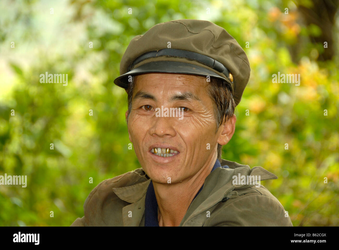 Portrait of a smiling communist wearing his uniform, near Luang Prabang, Laos, Southeast Asia - Stock Image