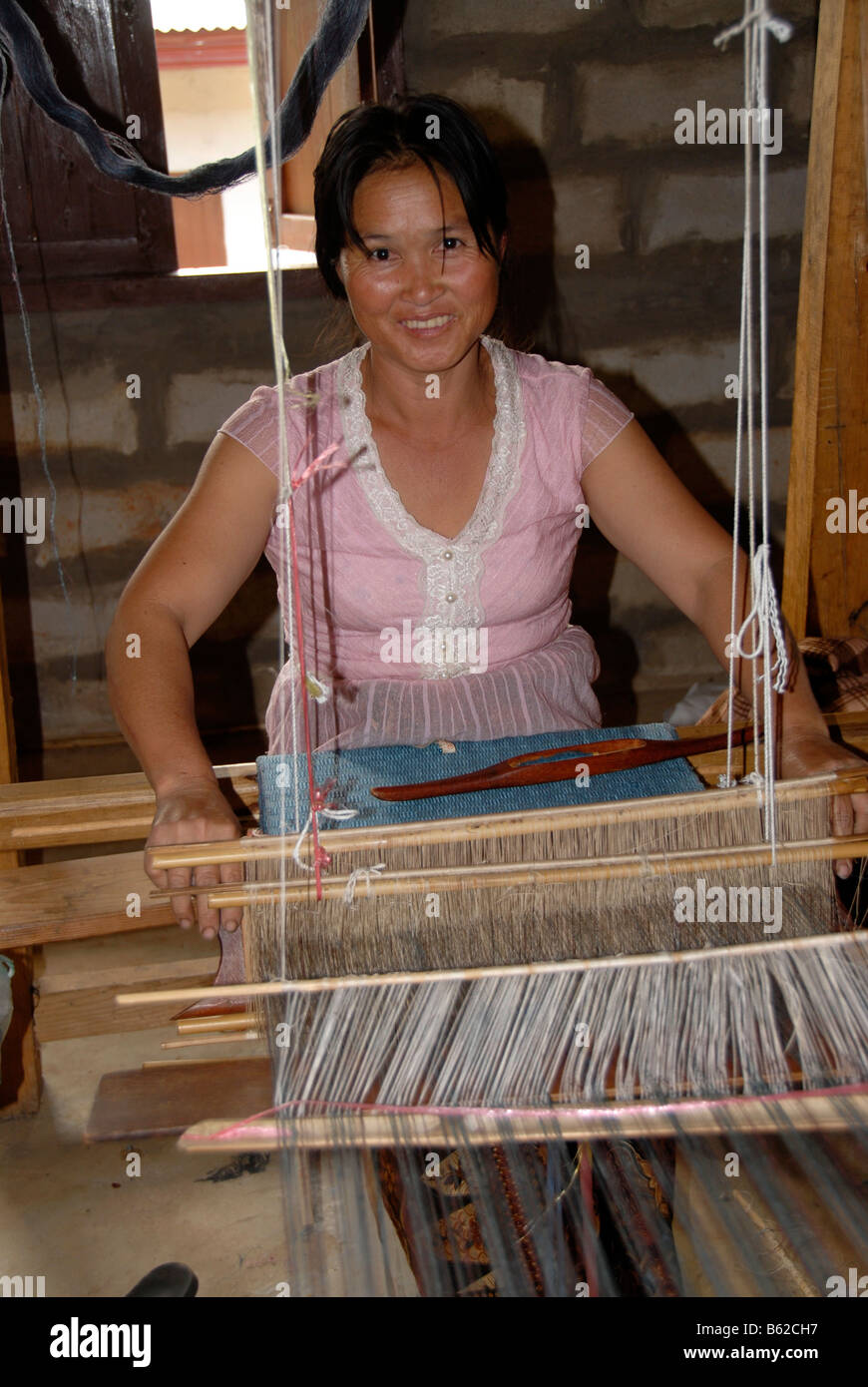 Handicraft, young woman weaving silk on a loom, Phonsavan, Xieng Khuang Province, Laos, Southeast Asia - Stock Image