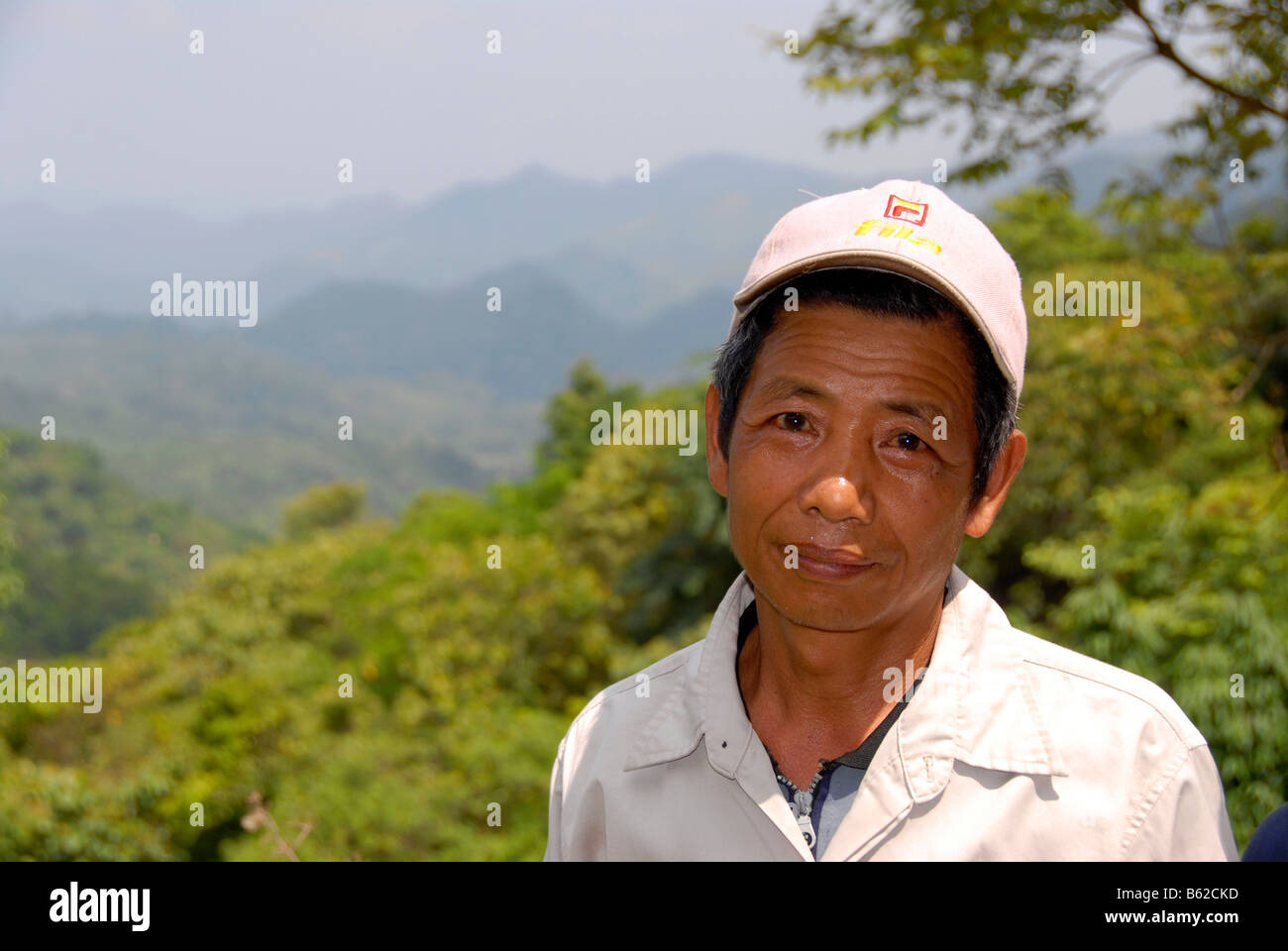 Laotian man, portrait, in natural mountain landscape, Phongsali Province, Laos, Southeast Asia - Stock Image