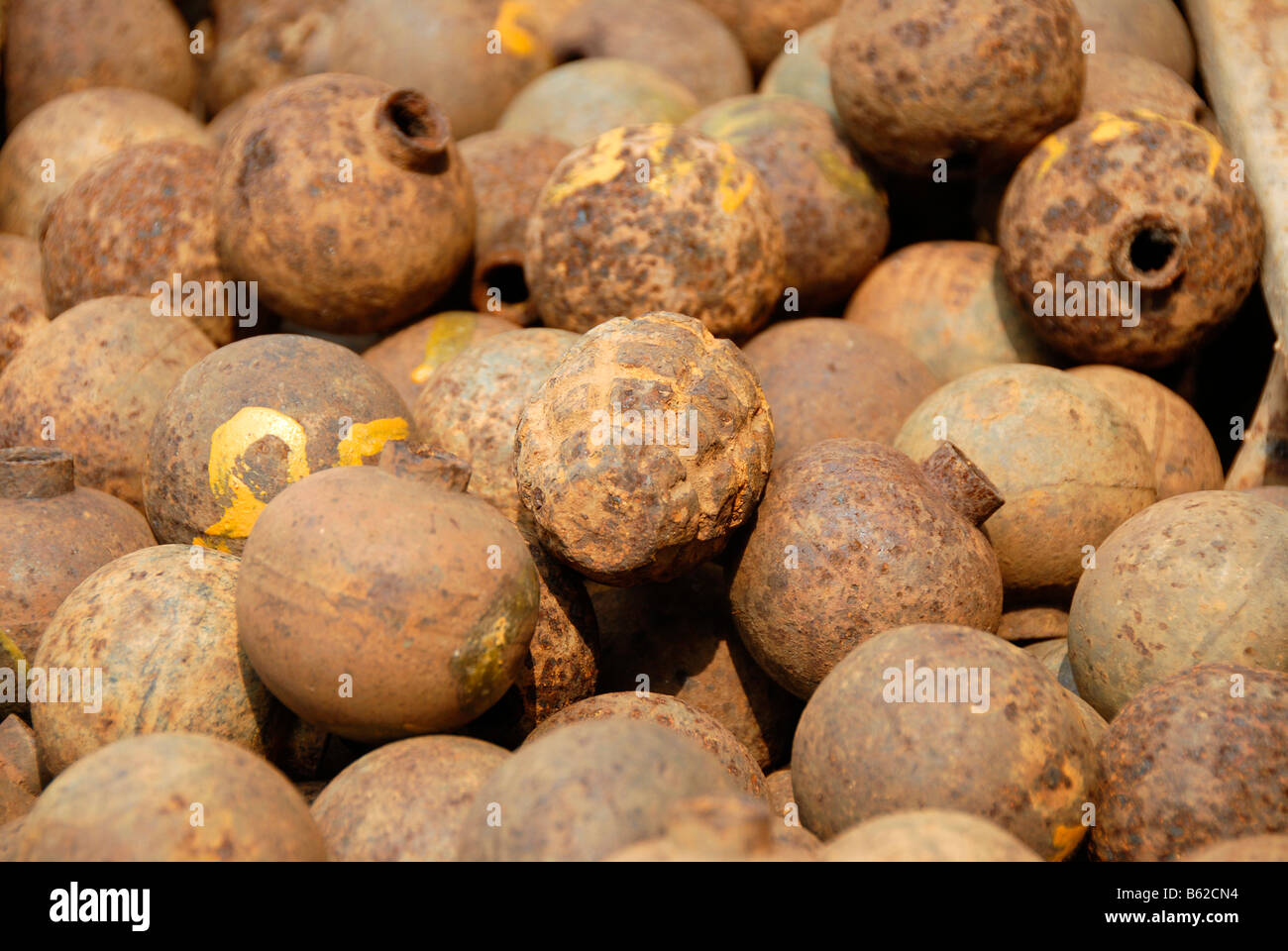 Collection of old rusty American bombs, 'Bombies', dropped on Laos during the 2nd Indochina war by the US - Stock Image