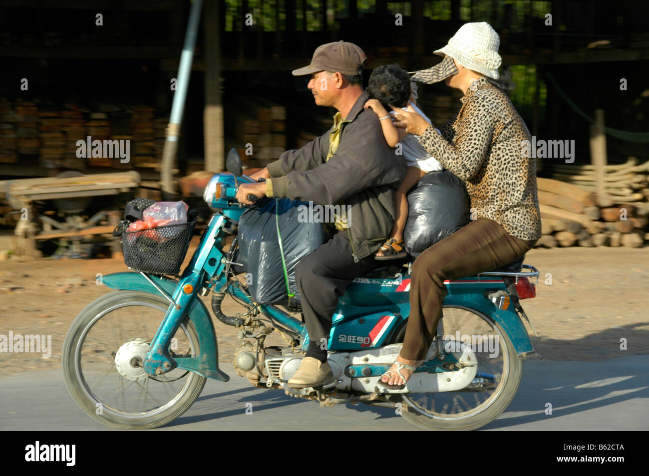 Crammed full motocycle with people and luggage, near Phnom Penh, Cambodia, Southeast Asia Stock Photo