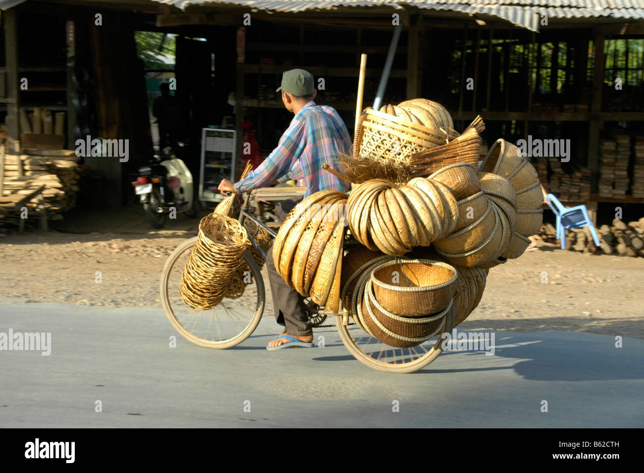 Crammed full bicycle with baskets, near Phnom Penh, Cambodia, Southeast Asia Stock Photo