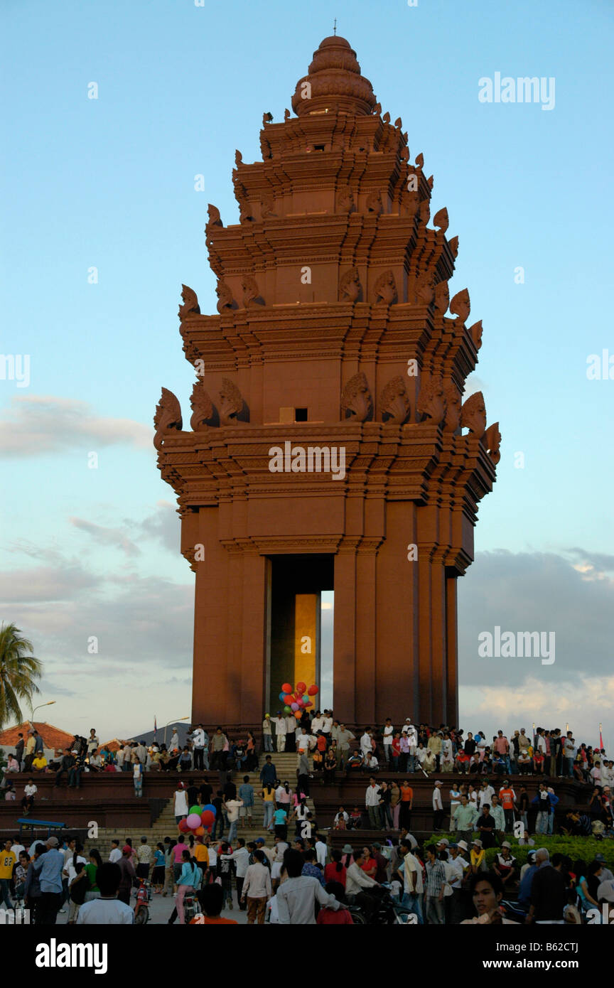 Many people standing below the Independance Monument, Water Festival, Phnom Penh, Cambodia, Southeast Asia Stock Photo