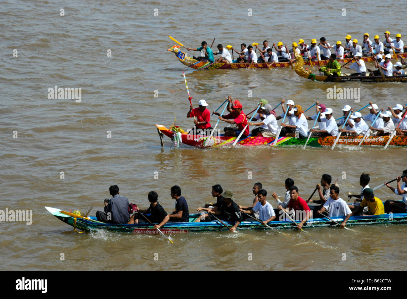Big rowing boats in competition with many rowers, Water Festival, Phnom Penh, Cambodia, Southeast Asia Stock Photo