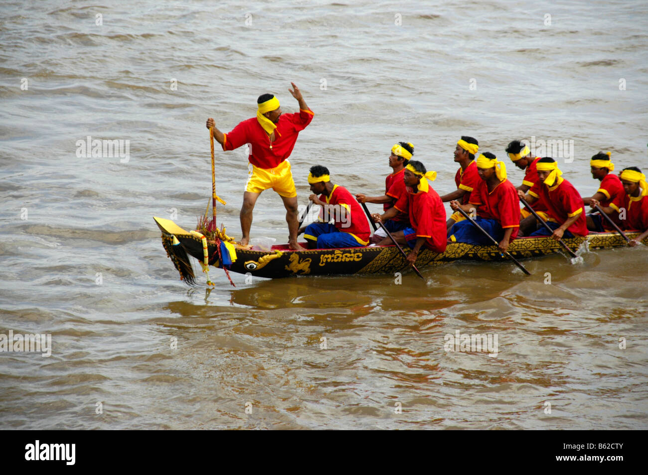 Big rowing boat with many rowers and the leading steering man, Water Festival, Phnom Penh, Cambodia, Southeast Asia Stock Photo