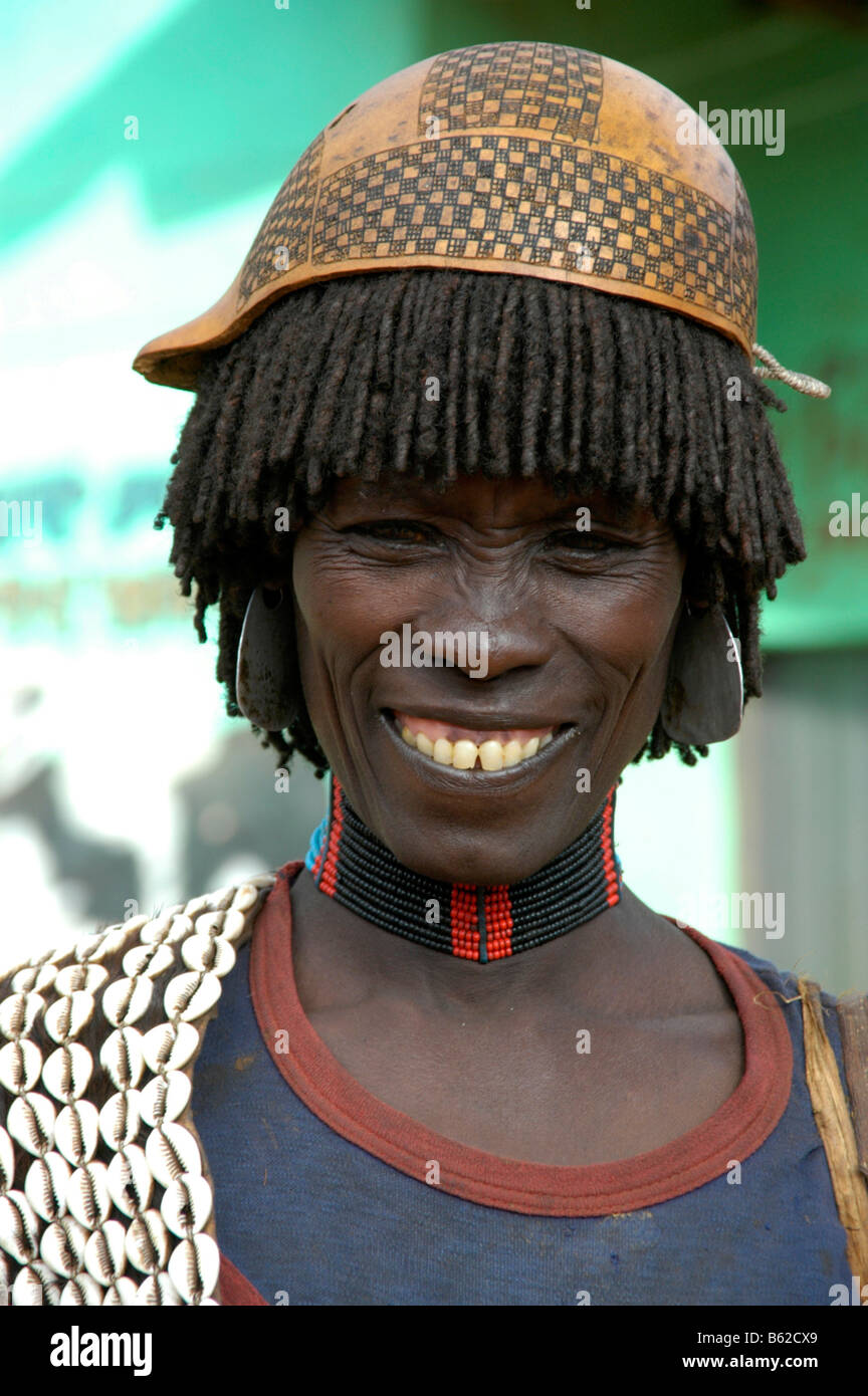Portrait of a woman wearing a necklace made of cowry shells, calabash on her head, Keyafer, Ethiopia, Africa - Stock Image