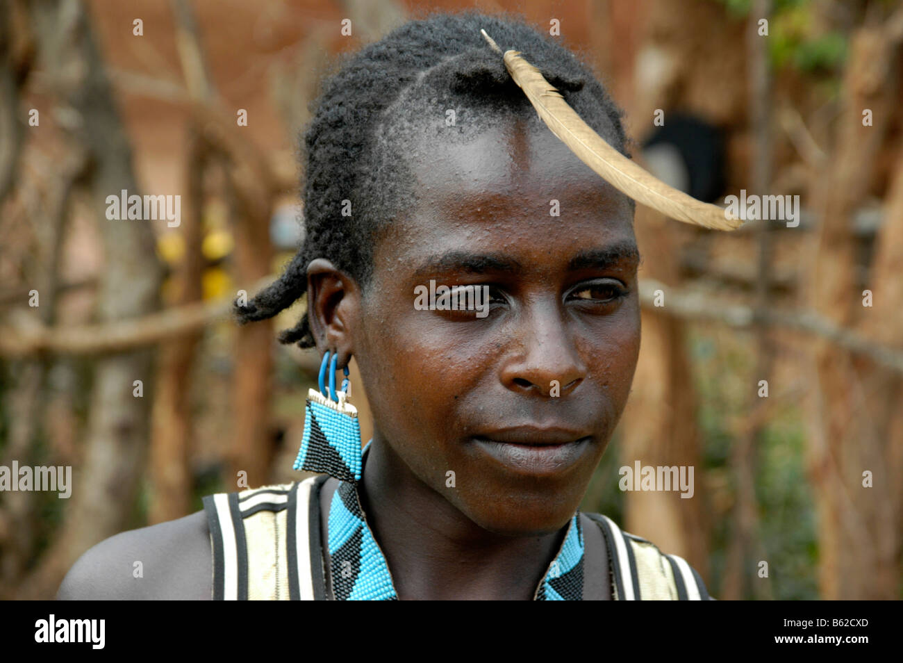 Portrait of a young man with a feather in his hair, Keyafer, Ethiopia, Africa - Stock Image