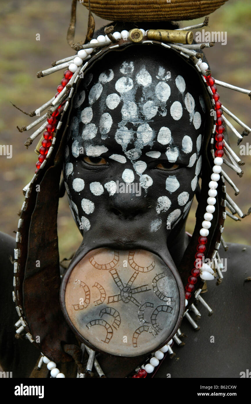 Portrait of a young woman from the Mursi tribe with a lip plate and white dots on her black face, near Jinka, Ethiopia, - Stock Image