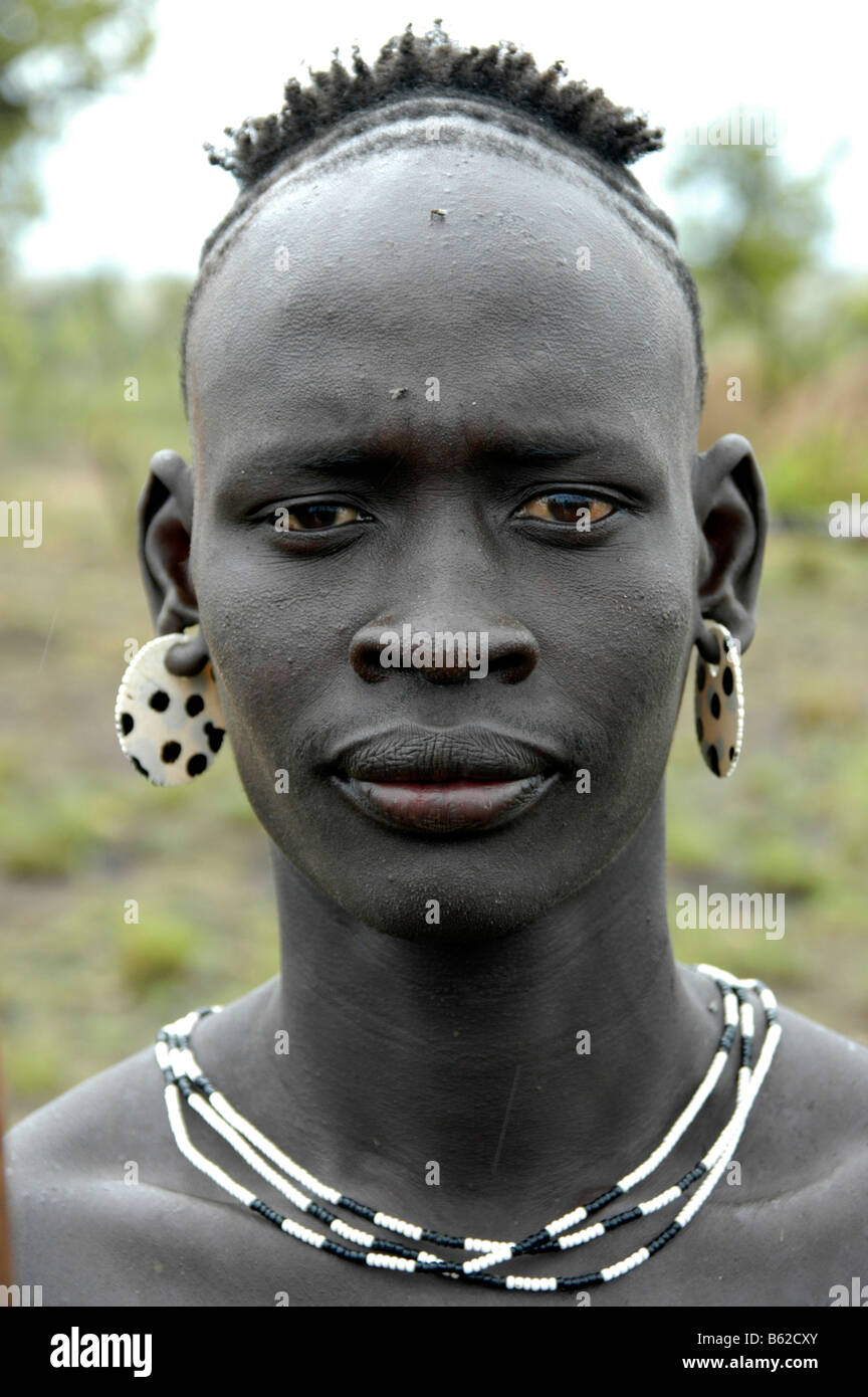 Portrait of a man of the Mursi tribe with a particular hairstyle, near Jinka, Ethiopia, Africa - Stock Image