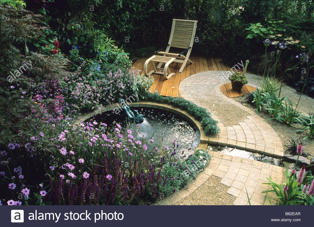 Feng Shui Garden Design Pamela Woods Circular Pool With Fountain Sculpture  Water Rill Meandering Cobblestone Path And Small Deck
