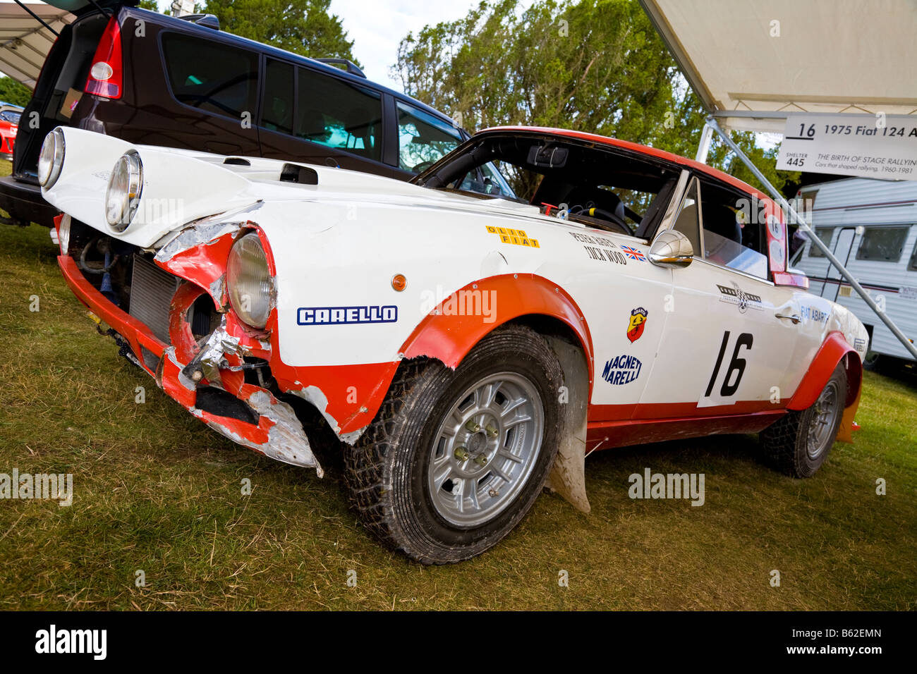 A Very Damaged 1975 Fiat 124 Abarth Rally Car In The Paddock At