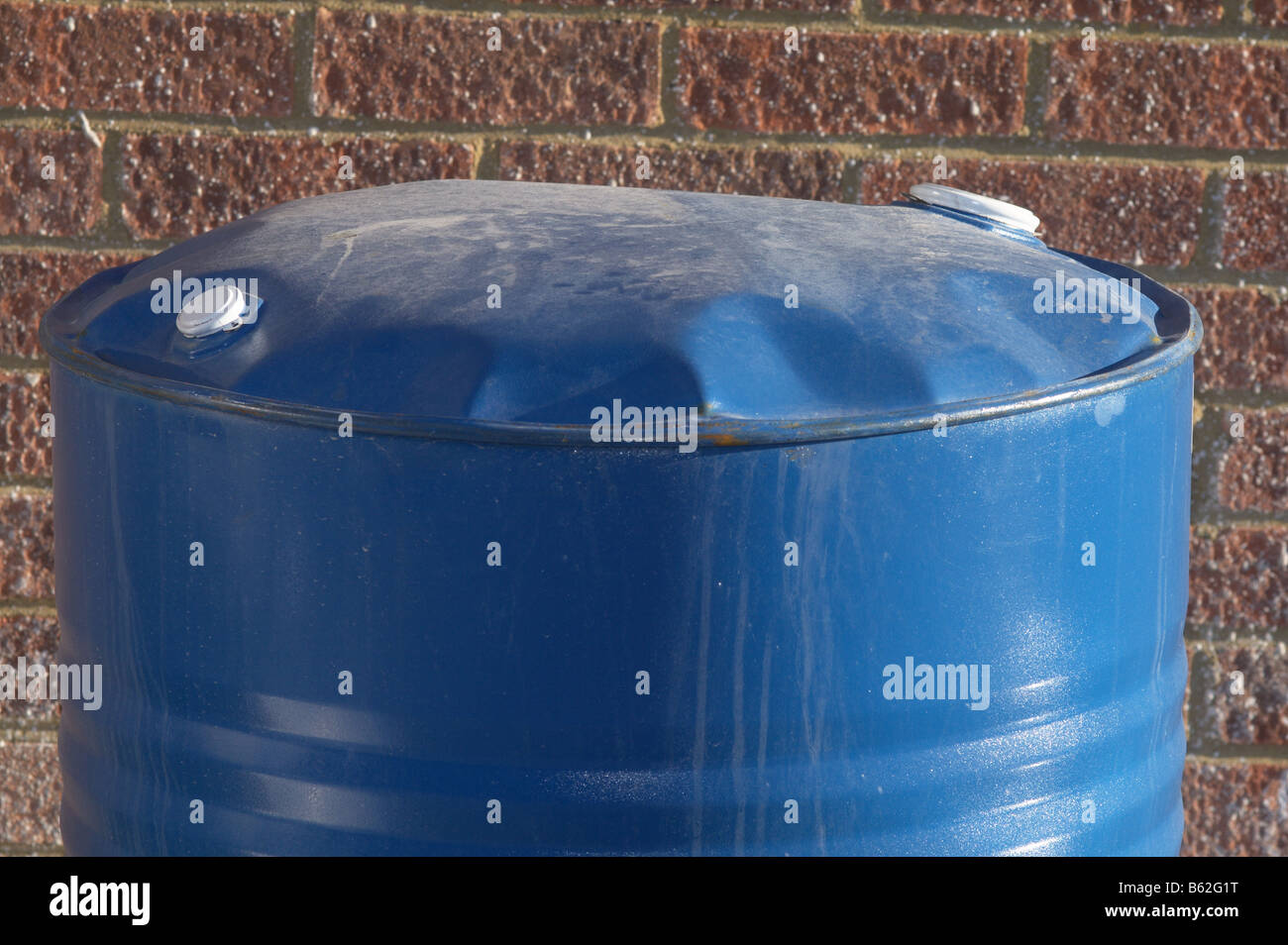 Bursting Drum which has been pressurised by its contents - Stock Image