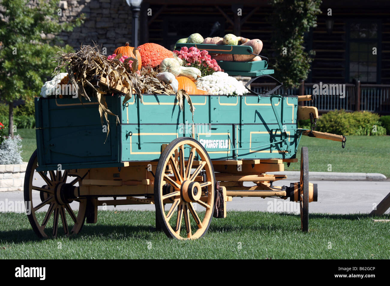 Fall Decorations In A Wooden Springfield Wagon Full Of Gourds Stock