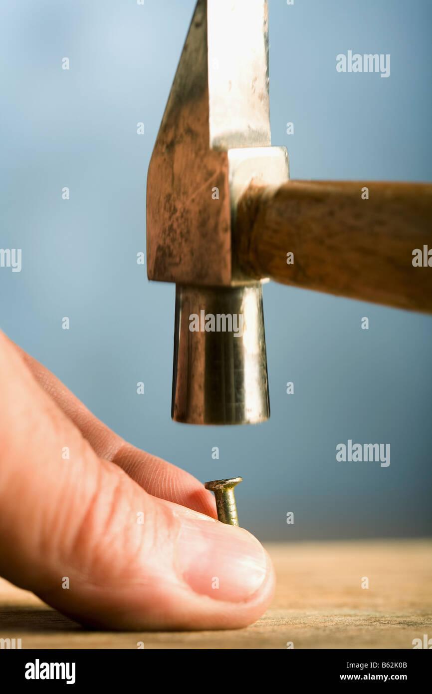 Hand Holding Hammer Hitting Nail Stock Photos & Hand Holding Hammer ...