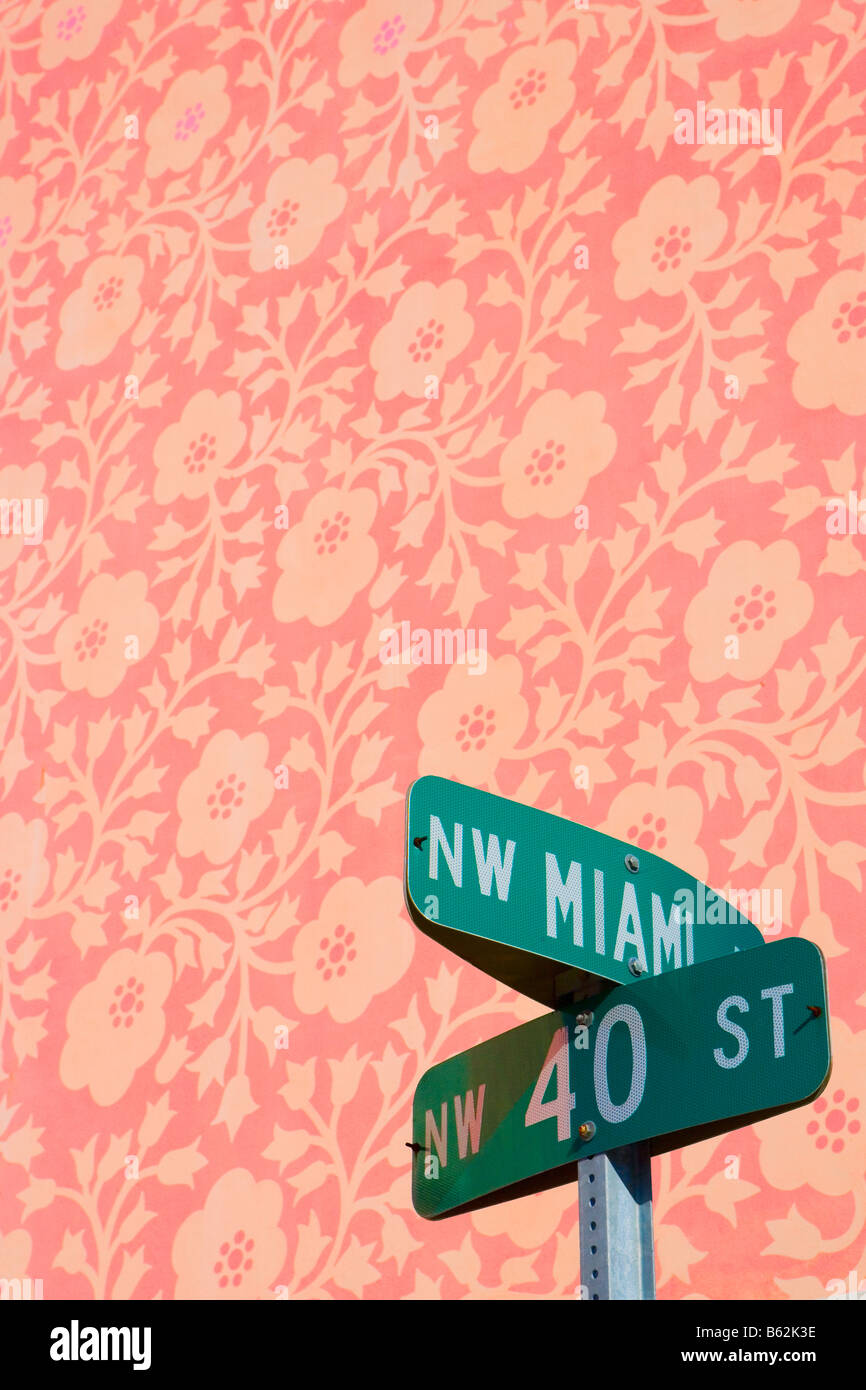 Close-up of a street name sign in front of a floral background, Miami Design District, Miami, Florida, USA