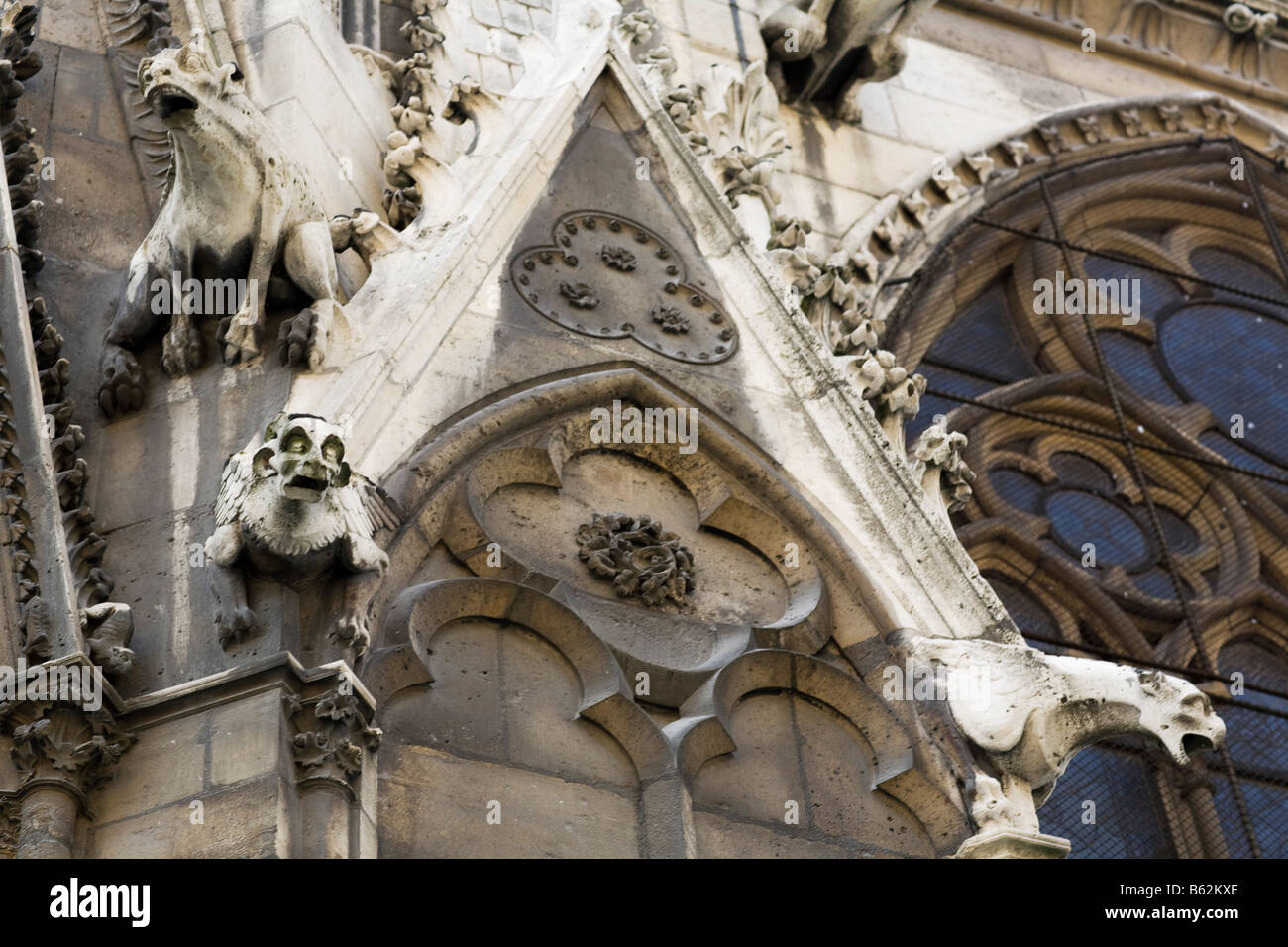 Gargoyles look down from the exterior walls of Paris' Cathedral of Notre-Dame - Stock Image
