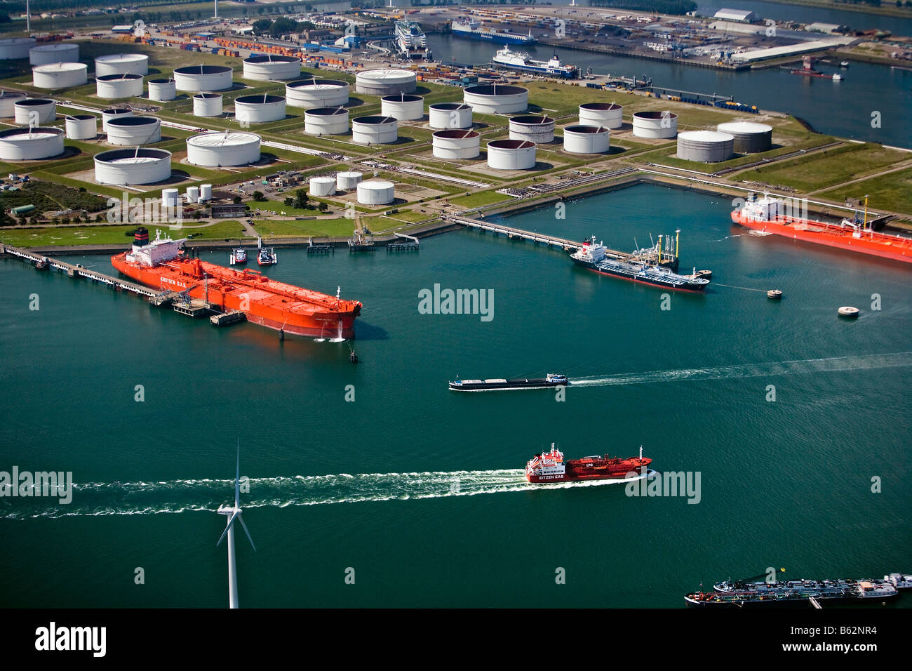 Holland Zuid Holland Rotterdam harbour Container ship and oil storage Aerial - Stock Image