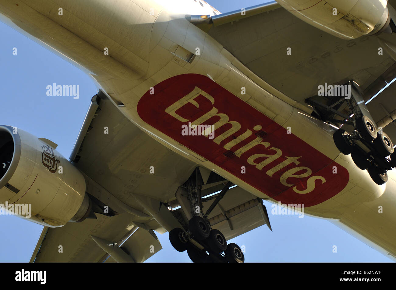 Emirates Airlines Boeing 777 aircraft landing at Birmingham International Airport England UK - Stock Image