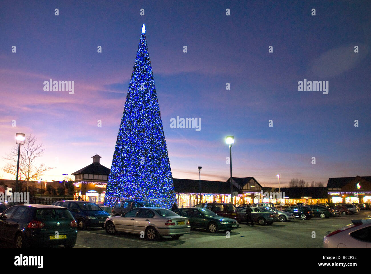 Christmas shopping lights and tree at Cheshire Oaks in Ellesmere Port Wirral. - Stock Image