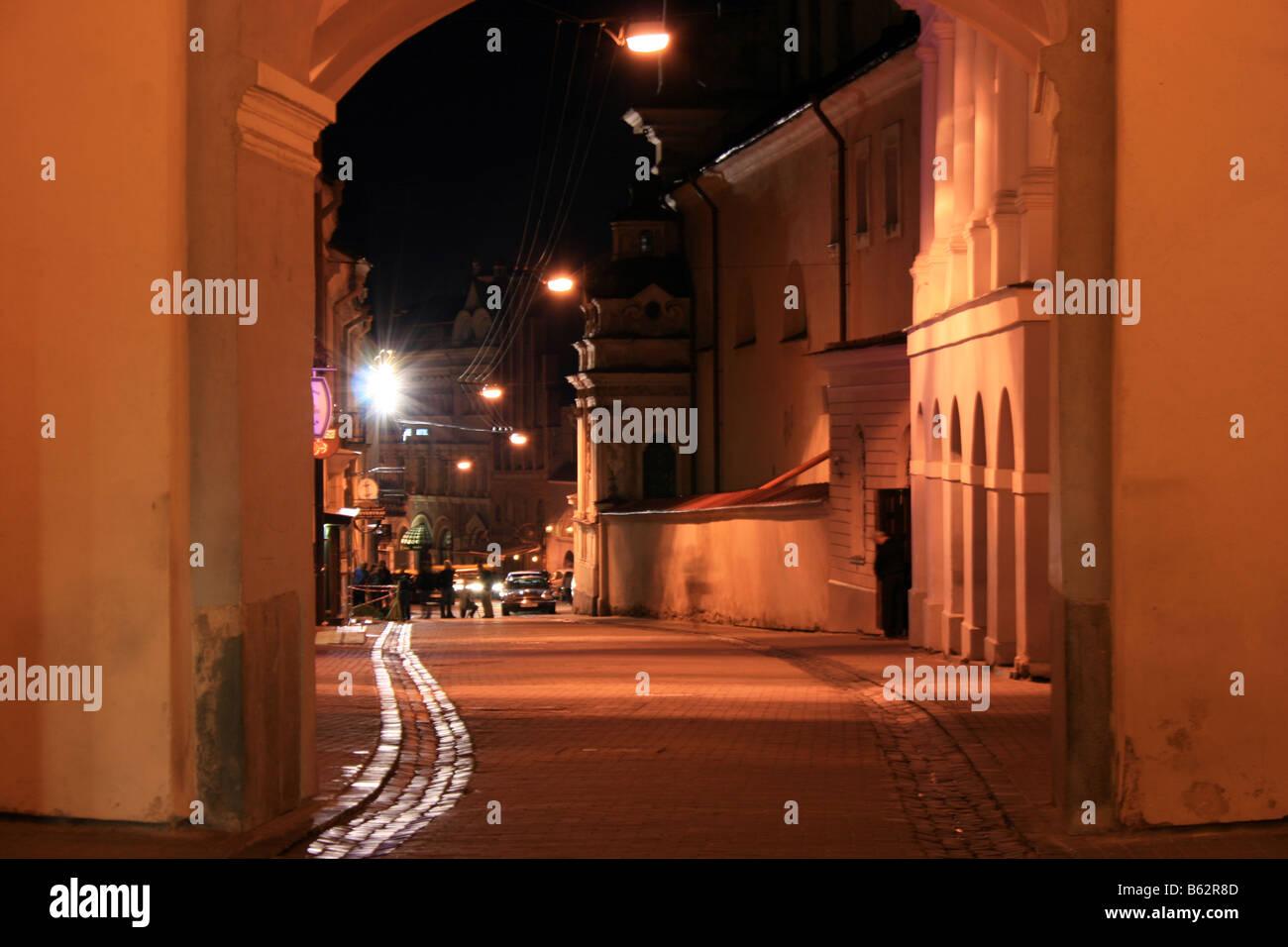Dawn Gate, night view to Ausros vartu street, Vilnius, Lithuania - Stock Image
