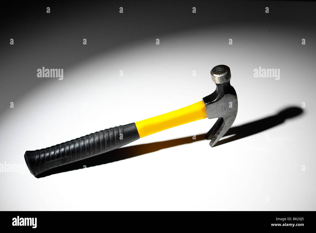 Claw hammer with strong shadow background Stock Photo