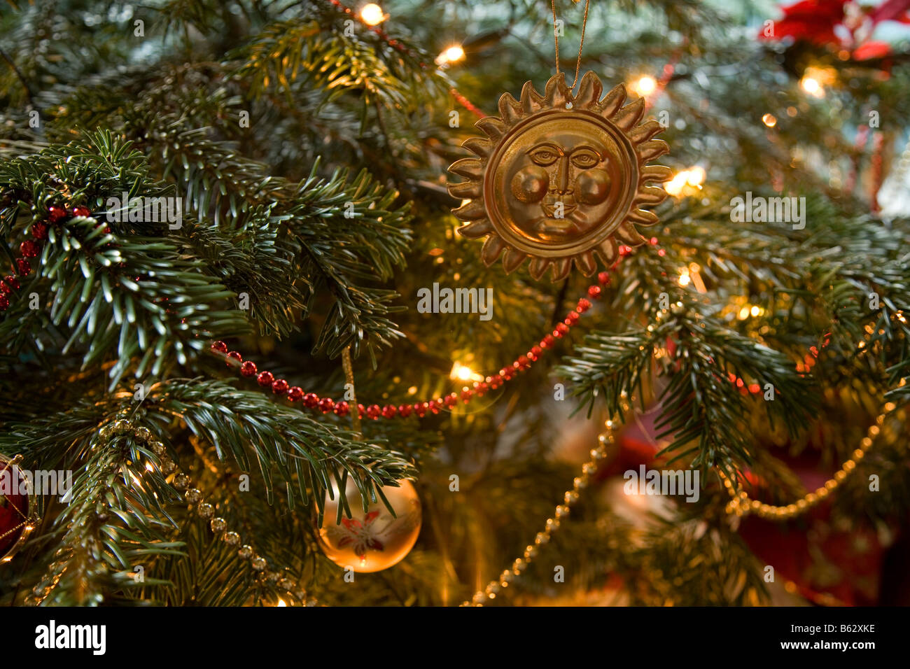 Christmas cards decorations of lights in red green and golden hues ...