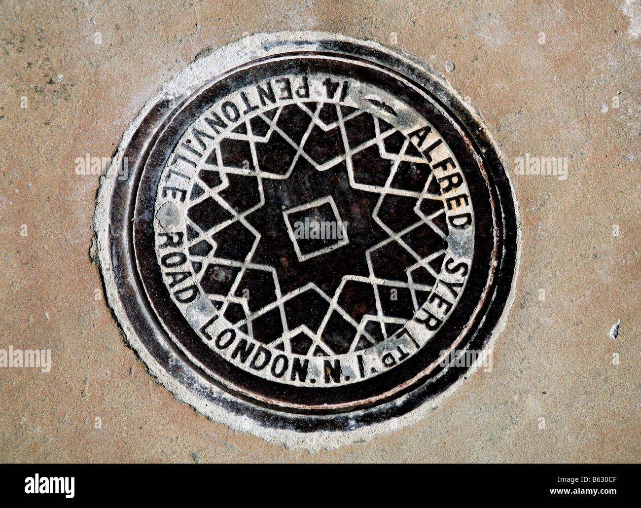Coal hole cover in London pavement - Stock Image