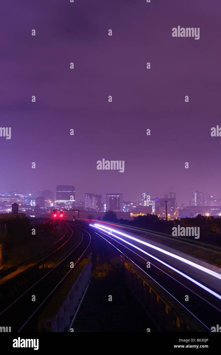 Rail transport link at night in Birmingham City Centre England - Stock Image