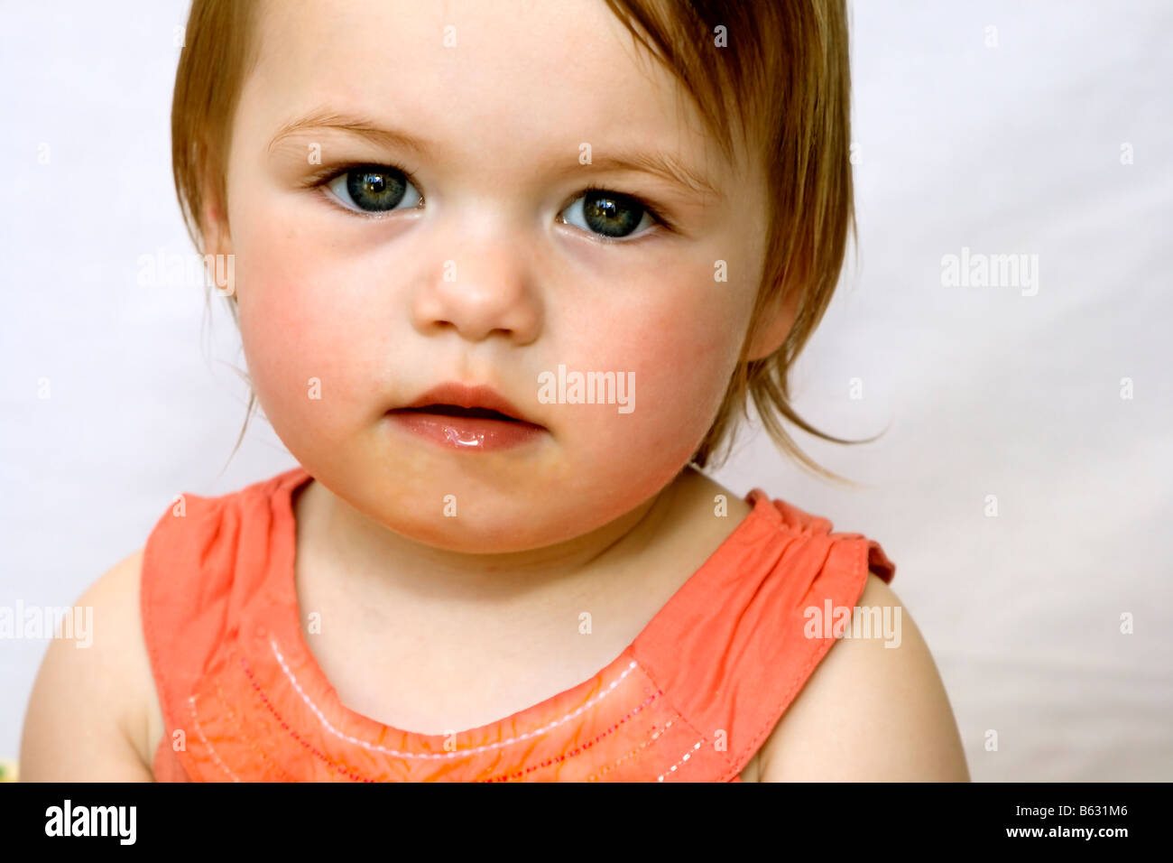 Portrait of a big-eyed baby girl. - Stock Image