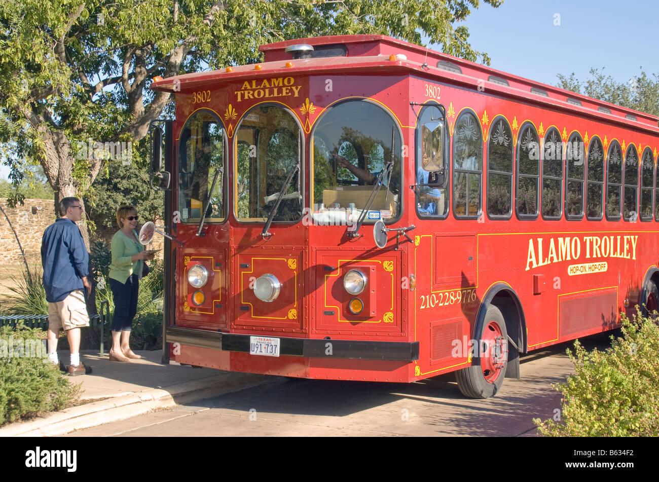 San Antonio, Alamo Trolley tour bus picking up passengers on The Mission Trail - Stock Image