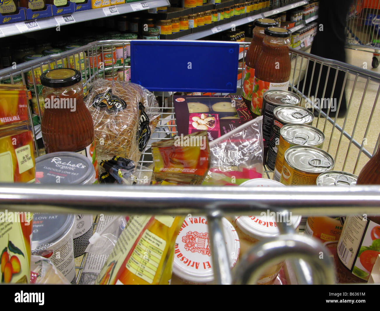 Shopping in trolley at supermarket - Stock Image