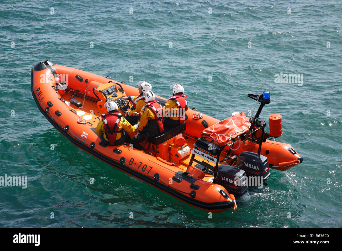RNLI orange powerboat dingy on an exercise drill. - Stock Image