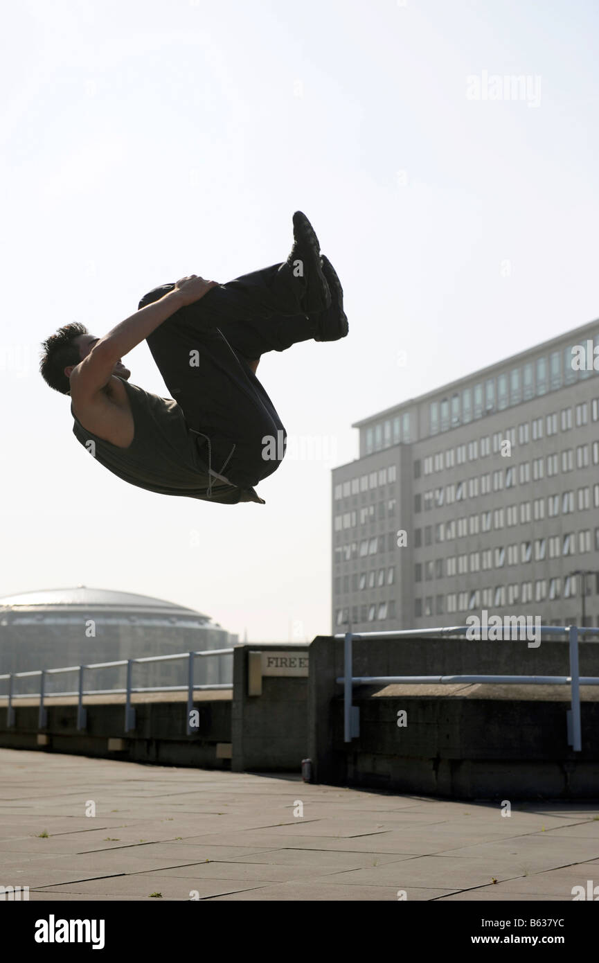 Danny Darwin demonstrating free running (parkour) techniques on the South Bank, London - Stock Image