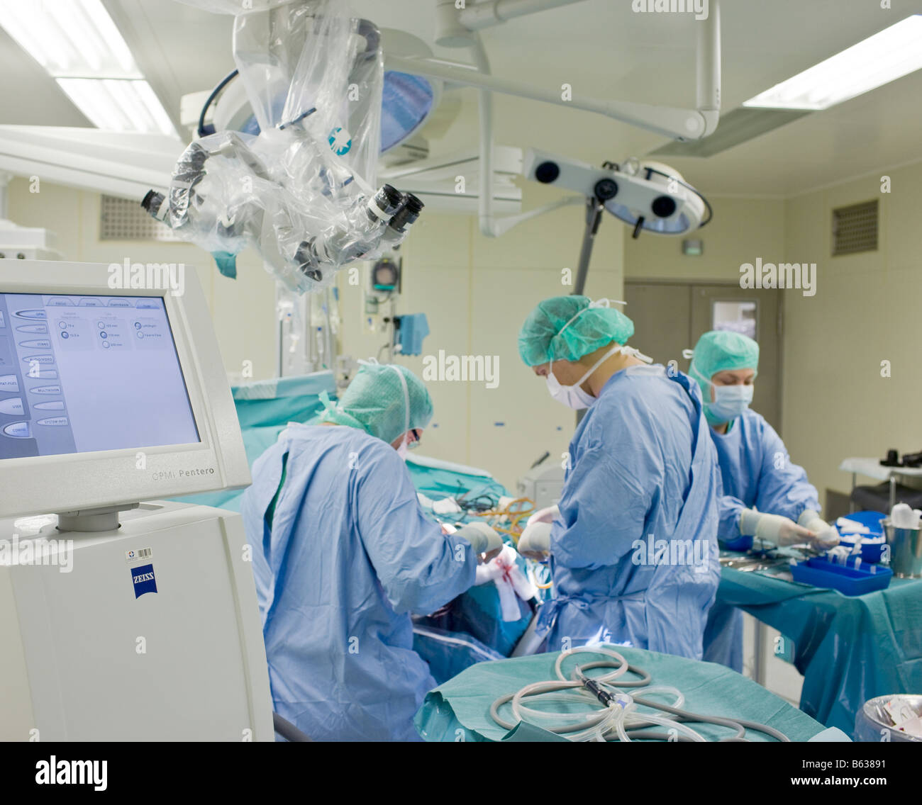 Neurosurgeons removing a benign brain tumor, Reykjavik, Iceland Stock Photo