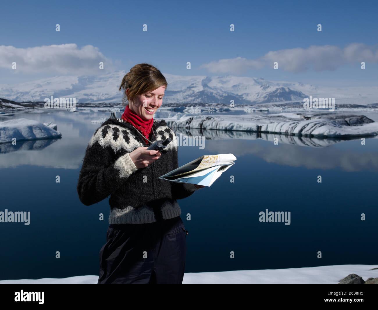 Icelandic girl with map at Jokulsarlon Glacial Lagoon, Breidamerkurjokull glacier, Eastern Iceland - Stock Image