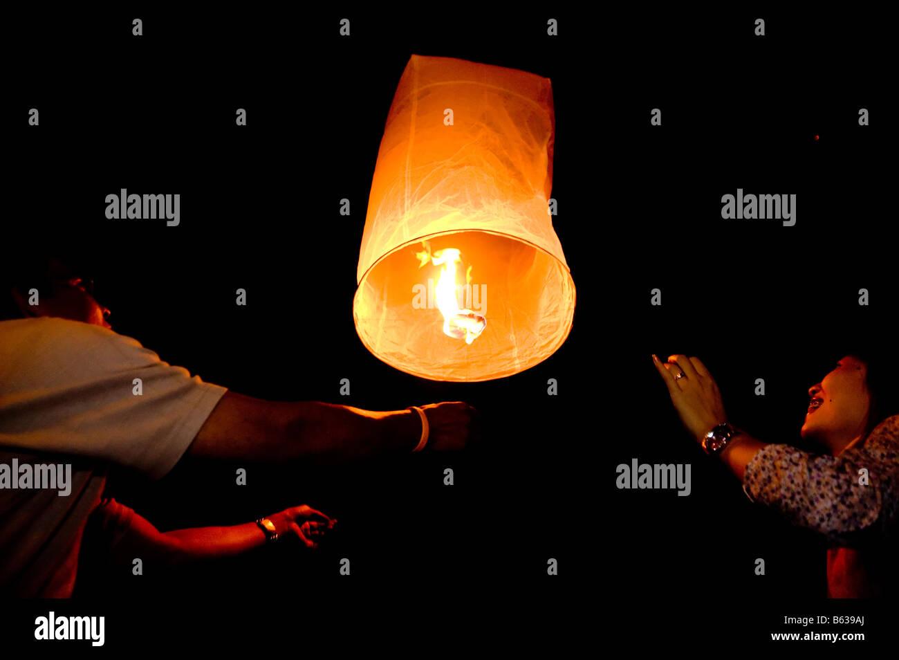 Loi Kratong Festival In Chiang Mai Thailand A Couple Light A Komloi Stock Photo Alamy