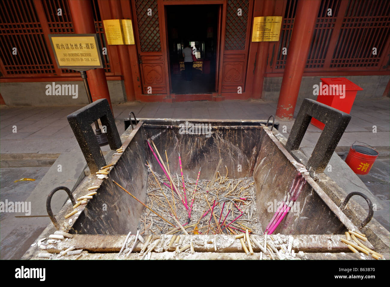 Smoking incense sticks burned as offering in theYongHeGong lama temple in Beijing, China Stock Photo