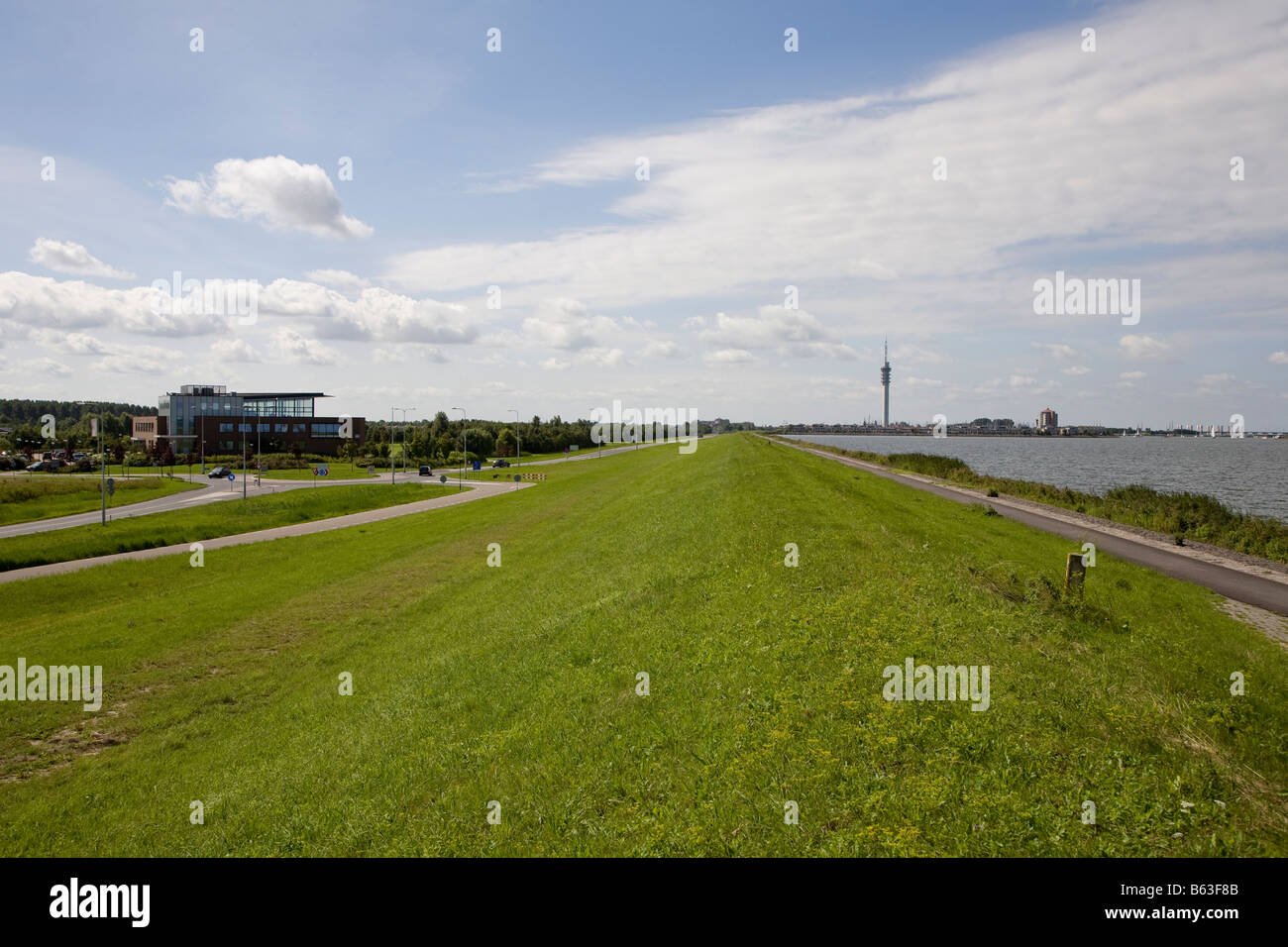 Dyke on reclaimed land protecting Lelystad from the IJsselmeer Flevoland Netherlands Stock Photo