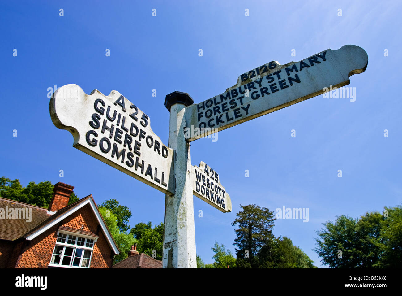Signpost giving directions to local villages at Abinger Hammer, Surrey, England, UK - Stock Image