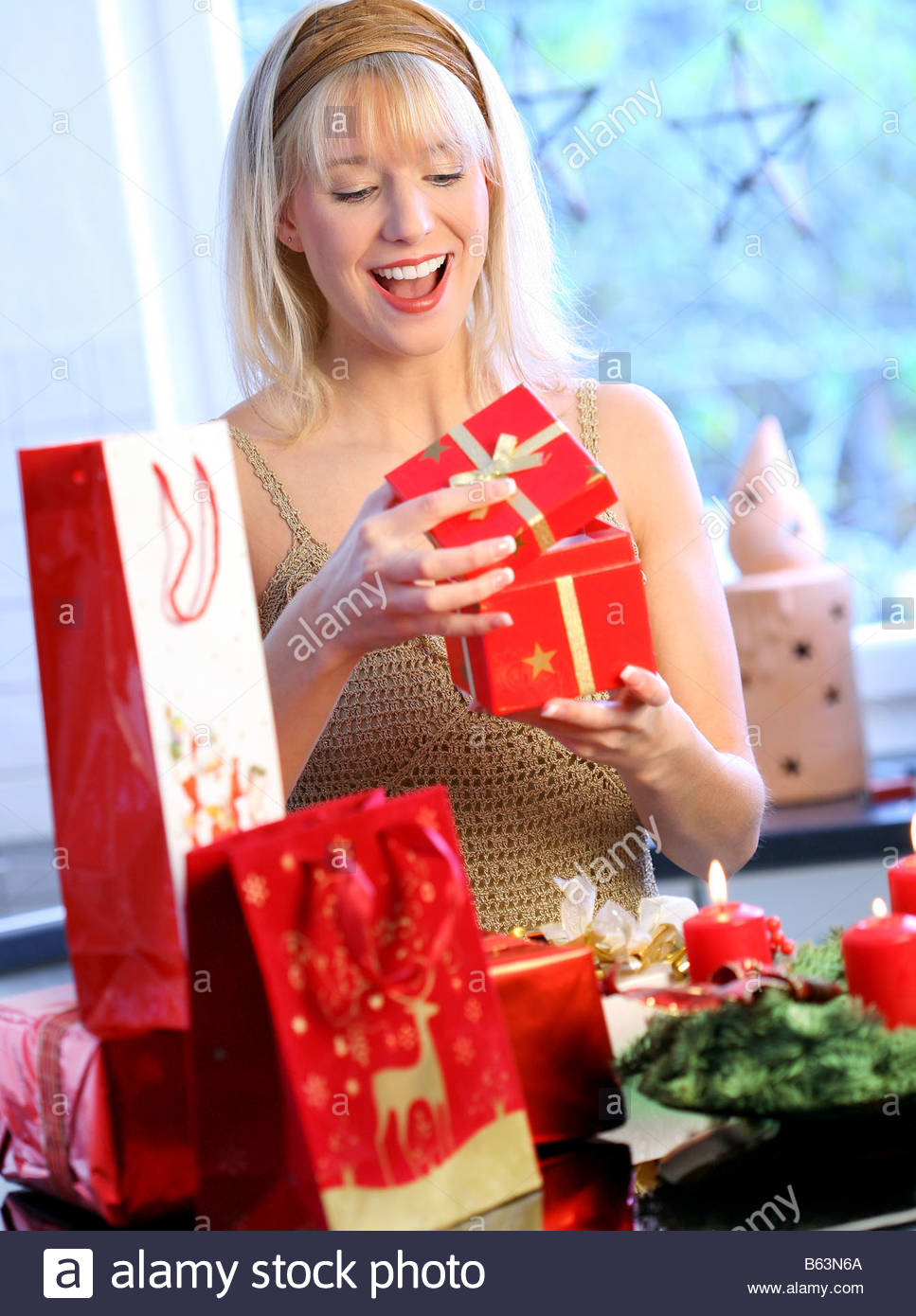 young blond woman holding christmas gifts in her hand Stock Photo ...