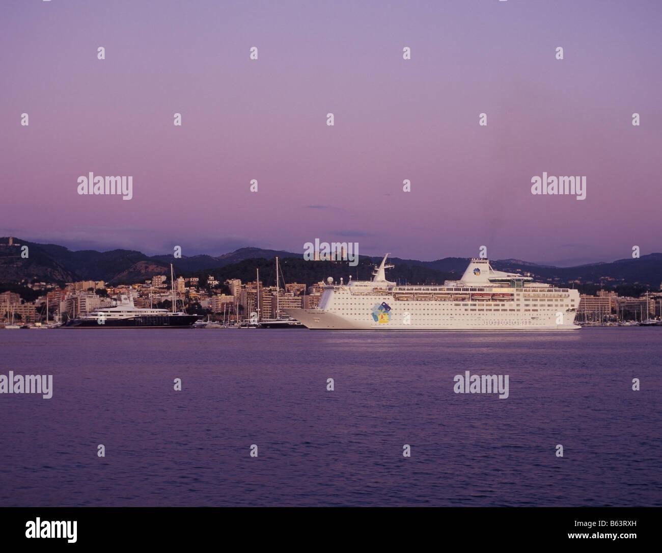 Island Cruises cruise liner Island Escape entering port at sunrise - Port of Palma de Mallorca, Balearic Islands, Stock Photo